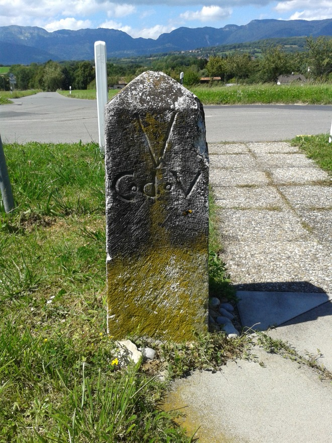 Border stone: now marking the border between the cantons of Geneva and Vaud. Formerly marking the border between France and Switzerland (dates from 1808)