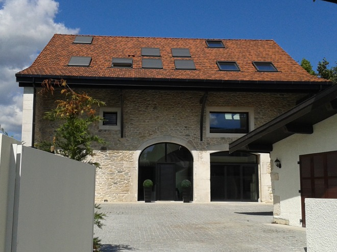 A refurbished barn in Grilly. What do you think: very covetable or a modernisation too far?