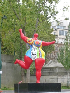 Nikki de Saint Phalle sculpture along the quay bearing her name.