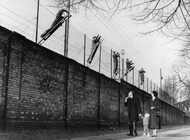 Berlin, Germany, 19th November, 1961, East Berlin border guards adding barbed wire to the newly built Berlin Wall, The wall was set up the Soviet army to prevent refugees escaping from the Soviet sector in the East to West Berlin (Photo by Popperfoto/Getty Images)