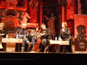From left to right: Donato Carrisi, interpreter, Carlos Zanon, Walter Lucius.