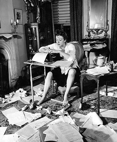 Picture credited to Gypsy Rose Lee, 1941: Women at Typewriter