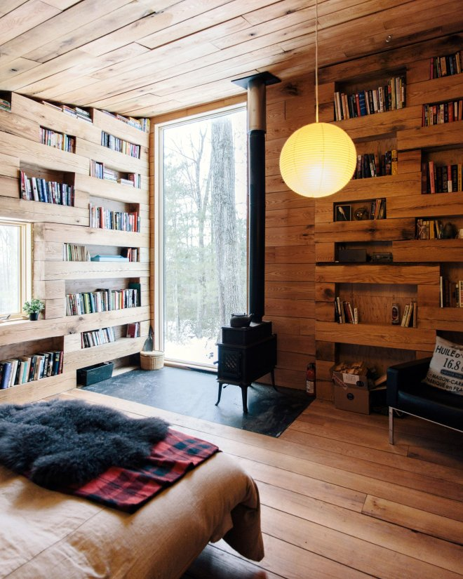 Books, views and a stove appear to be indispensable items, from dezeen.com