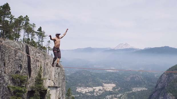 Any chance of bridging that precipice? From Vancouver Sun, a fearless (or foolish) slackliner.